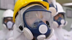 U.S. Ambassador to Japan Caroline Kennedy wearing a yellow helmet and a mask inspects the central control room for the Unit 1 and Unit 2 reactors of the tsunami-crippled Fukushima Daiichi nuclear power plant last month. AP /Toru Yamanaka
