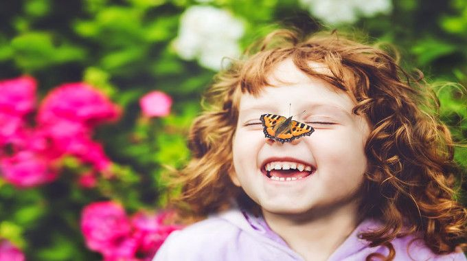 laughing girl with butterfly on her nose-compressed