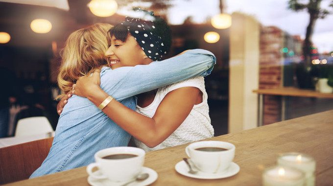 girl-friends-embracing-in-a-coffee-shop-compressed