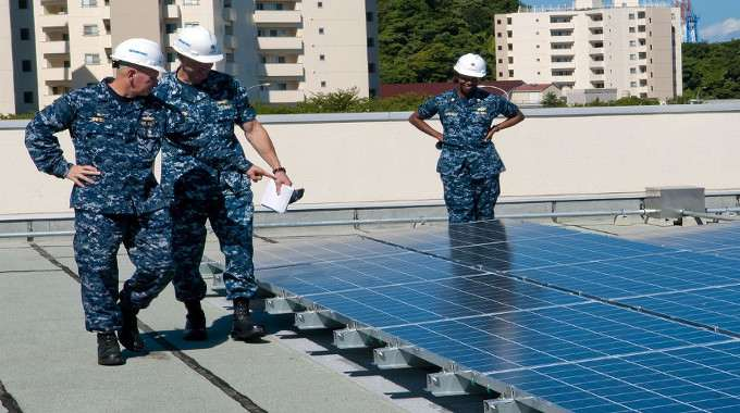 soldiers-looking-at-solar-panels-compressed