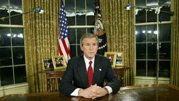 "President George W. Bush announcing the start of war between the United States and Iraq during a televised address from the Oval Office on March 19, 2003, saying that the U.S. military struck at ""targets of opportunity"" in Iraq."