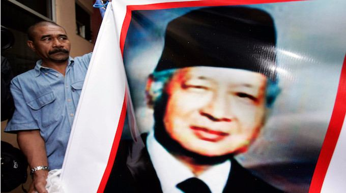 As Indonesia's former President Suharto lay ill in 2008, a supporter displayed a portrait of him outside the Jakarta hospital where the military dictator died two weeks later. It was in Suharto's brutal three-decade reign that Indonesia invaded East Timor, where investigative journalist Allan Nairn covered atrocities the general's troops committed. (Vincent Thian / AP)
