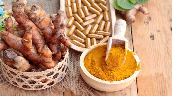 turmeric-powder-with-tumeric-capsules-for-health-compressed